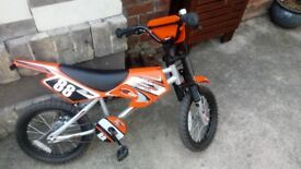 Kids bike 6-8yr old moto-pedal bike excellent condition as new