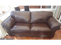2 Seater chocolate brown Genuine leather sofa reluctant sale due to lack of space very comfortable
