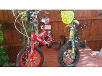 Green and Red children's bikes for sale
