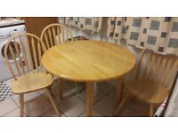 Wooden fold up table and 3 chairs