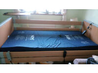ONLY 3 MONTHS OLD-GOOD AS NEW-INCLUDES MATRESS AND STURDY OVER BED TABLE ON CASTORS