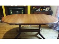 Dark wood extendable oval dining table