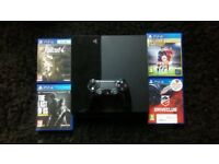 500GB Playstation 4. ps4 + 4 games + controller.