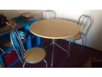 Kitchen/dining table with three chairs