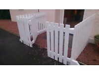 Outdoor sturdy wooden pet or child safety gate/fence.