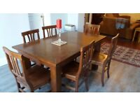 Lovely mango wood extending table + 6 matching chairs.