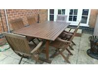 Large garden table and 8 chairs