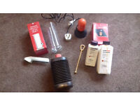 Photographic darkroom equipment; safelight, developing chemicals, bottle and measuring cylinder