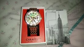 rose gold coloured watch (caravelle)