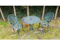 Vintage cast green table and two chairs