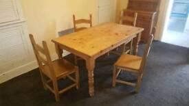 Quick sale. Reduced 5' x 3' Rustic dining table and four heavy chairs