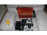 canon A1 35mm SLR camera with Canon flash unit and battery pack and bag