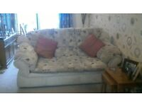 sofa and two matching arm chairs