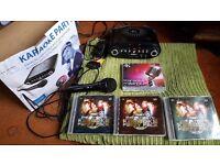 Karaoke c/d machine with lyrics on your tv screen + microphone, 3 double & 1 triple c/d packs.