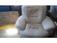 2 cream leather swivel armchairs. chrome feet.