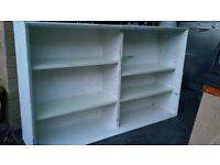 Large solid white bookcase with adjustable shelves