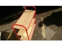 Red metal/wood shelving rack
