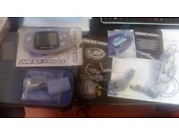 Nintendo Gameboy Advance Glacier Boxed with all Accessories. Mint condition.