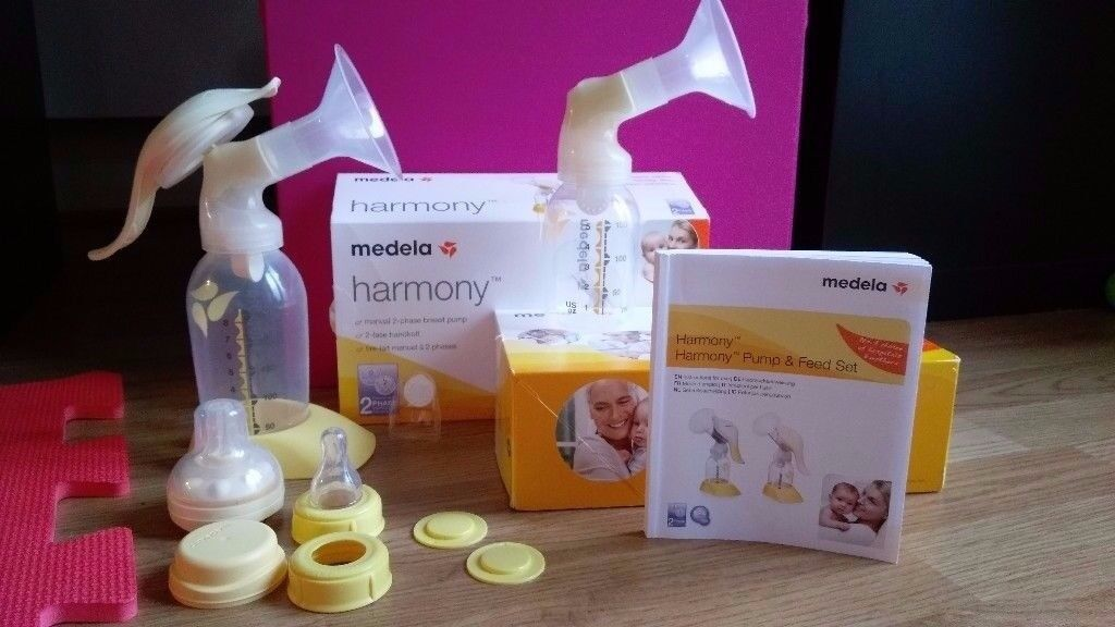 Medela Manual Breast Pump with Extras - Used twice!