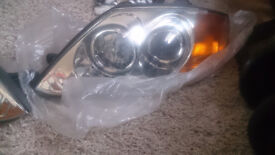 Hyundai Coupe (Gen II) Headlights (NOT FADED, SCRATCHED or DISCOLOURED). From 2003 car with bulbs.