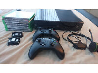 xbox one with 2 controllers and 6 games