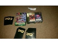 Yugioh tin and 100 cards and ninja sleeves
