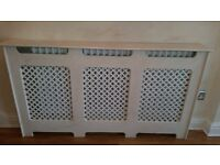 Radiator cover with marble effect. Height 82cm width 149cm depth 18.5cm.