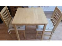 Small pine table and two chairs