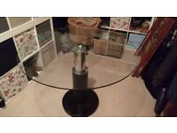 Glass dining table and 4 cream leather chairs quick sale