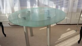Glass Topped Dining Table with glass shelf underneath