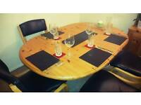 Solid oak wood table & 6 leather chairs.