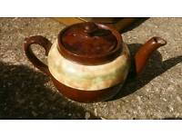 A small brown teapot