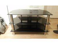 Black glass TV stand. Good quality. Must be able to collect.
