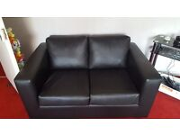 2x2 black leather sofas.