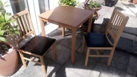 Wooden table and 2 chairs.Table measures 69 cm by 69 cm