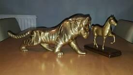 Brass lion and brass horse