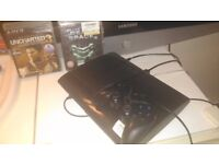 Ps3 slim with two games