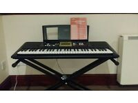 Yamaha digital keyboard complete with stand and manual