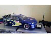 Rc nitro carz a twin speed evo hpi and a thunder tiger.all working fine no time now .