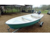 Dinghy boat unsinkable with 4hp outboard engine and trailer.