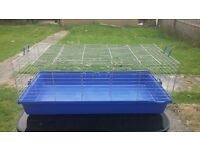 4ft x 2ft Indoor rabbit cage, more than roomy enough for 1 large rabbit or 2 smaller rabbits.