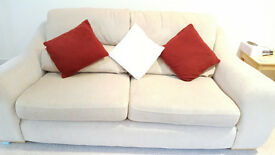 Beige sofa and matching swivel chair free to a good home!
