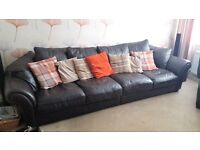 Large leather corner suite ,seats six + comfortably.