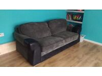 1x GREY AND BLACK 4 SEATER SOFA BED DFS VERY GOOD QUALITY