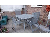Garden dining set Square metal table with 2 armchairs and 2 recliner chairs complete with cushions