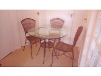 Circular glass top dining table and 4 chairs.