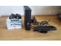 Xbox 360 slim 4GB with Kinect sensor and 9 games. Almost new.