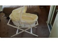 Mamas and Papas white wicker moses basket. Comes with the stand and a new mattress.