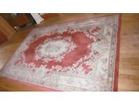 Thick, luxurious red carpet / rug. Traditional pattern.