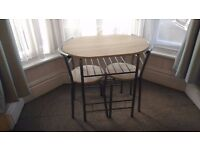 2 chairs and table compact dining room set